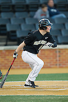 Jonathan Pryor (11) of the Wake Forest Demon Deacons follows through on his swing against the Missouri Tigers at Wake Forest Baseball Park on February 22, 2014 in Winston-Salem, North Carolina.  The Demon Deacons defeated the Tigers 1-0.  (Brian Westerholt/Four Seam Images)