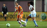 Sky Blue's Heather O'Reilly (9)  looks to pass back as Chicago's Chioma Igwe (12) contains.  Sky Blue defeated the Chicago Red Stars 1-0 in a mid-week game, Wednesday, June 17, at Yurcak Field.