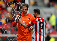 22nd May 2021; Brentford Community Stadium, London, England; English Football League Championship Football, Playoff, Brentford FC versus Bournemouth; Emiliano Marcondes of Brentford trying to take the bottle away from Goalkeeper Asmir Begovic of Bournemouth