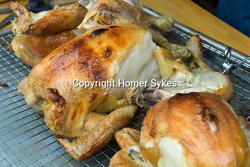 Rotisserie free range chicken grown at Fosse Meadows Farm Leicestershire UK 2010s