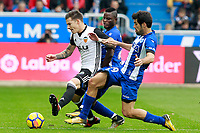 Deportivo Alaves' Wakaso Mubarak (c) and Manu Garcia (r) and Valencia CF's Santi Mina during La Liga match. October 28,2017. (ALTERPHOTOS/Acero) /NortePhoto.com