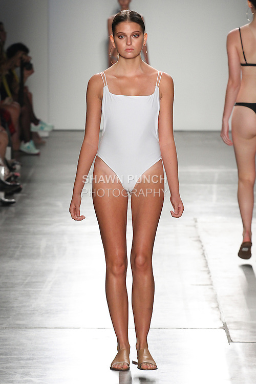 Models walk runway in outfits from the Ark Swimwear Spring Summer 2017 collection for the Fashion Palette Austrialian Swim Resort Spring Summer 2017 fashion show on September 8, 2016.