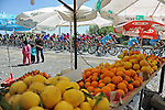The peloton pass by a fruit stall during Stage 4 of the 2015 Presidential Tour of Turkey running 132km from Fethiye to Marmaris. 29th April 2015.<br /> Photo: Tour of Turkey/Mario Stiehl/www.newsfile.ie