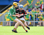 Neil Hegarty of Kilnamona in action against Max Bogenberger of Mountshannon/Lackyle during their Schools Division 3 final at Cusack Park. Photograph by John Kelly