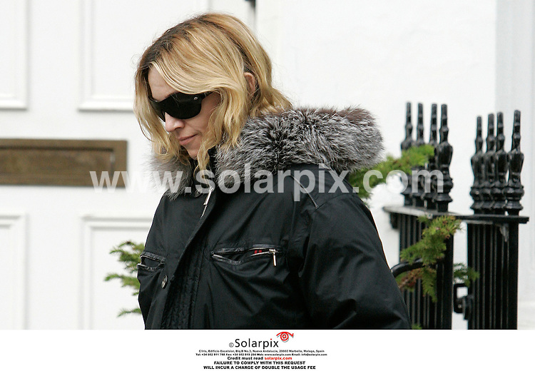 ALL ROUND  EXCLUSIVE PICTURES BY SOLARPIX.COM.***NO PUBLICATION IN FRANCE, SCANDANAVIA, AUSTRALIA AND GERMANY** NO UK NEWSPAPER PUBLICATION - UK MAGAZINES ONLY**.MUST CREDIT SOLARPIX.COM OR DOUBLE FEE WILL BE CHARGED.Is she fit to be a mother?.Even though the baby boy Madonna is hoping to adopt arrived in London this morning the pop star still managed to find time to go to the gym..13 month baby boy David Banda arrived from Malawi early  this morning and Madonna is pictured leaving the London gym this afternoon picking up a parking ticket on the way out...JOB REF: 2926 SFE