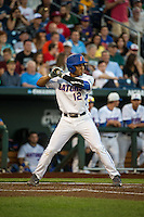Richie Martin (12) of the Florida Gators bats during a game between the Miami Hurricanes and Florida Gators at TD Ameritrade Park on June 13, 2015 in Omaha, Nebraska. (Brace Hemmelgarn/Four Seam Images)