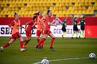 Tessa Wullaert (9) of Belgium with Lenie Onzia (8) of Belgium and Laura Deloose (22) of Belgium  pictured during the warming up of a friendly female soccer game between the national teams of Germany and  Belgium , called the Red Flames  in a pre - bid tournament called Three Nations One Goal with the national teams from Belgium , The Netherlands and Germany towards a bid for the hosting of the 2027 FIFA Women's World Cup , on Sunday 21 st of February 2021  in Aachen , Germany . PHOTO SPORTPIX.BE   SPP   STIJN AUDOOREN