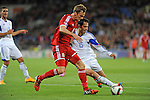 UEFA European Championship at Cardiff City Stadium - Wales v Cyprus : <br /> Andy King of Wales and Marios Antoniades of Cyprus tussle for the ball.