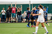TACOMA, WA - JULY 31: Eugenie Le Sommer #9 of the OL Reign celebrates with her teammates after her goal during a game between Racing Louisville FC and OL Reign at Cheney Stadium on July 31, 2021 in Tacoma, Washington.