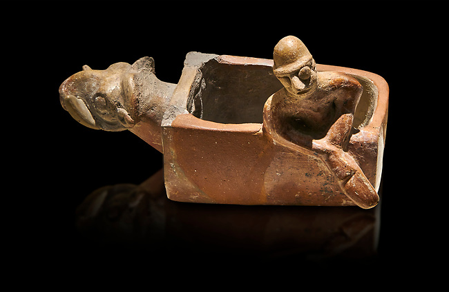 Assyrian Trader Colony Bronze Age terracotta sandal shaped ritual vessed. This cult pot is boat shaped with an animal head at the front. Inside the vessel is god. The deities associated with the ritual vessel were associated with trade and transportation in Ancient Mesopotamia and Summerian literature. The vessel signifies a religious river trip.  - 19th  century BC - Kültepe Kanesh - Museum of Anatolian Civilisations, Ankara, Turkey.  Against a black background.