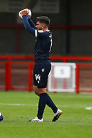 Alex Kenyon of Morecambe holds up the burst ball during Crawley Town vs Morecambe, Sky Bet EFL League 2 Football at Broadfield Stadium on 17th October 2020