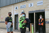 Football fans queue up out side The New Lawn stadium as they take part in a pilot to let fans back in stadiums before during the Sky Bet League 2 match between Forest Green Rovers and Bradford City at The New Lawn, Nailsworth, England on 19 September 2020. Photo by Thomas Gadd.