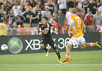 Andy Najar #14 of D.C. United moves away from Andrew Hainault #31 of the Houston Dynamo during an MLS match at RFK Stadium in Washington D.C. on September  25 2010. Houston won 3-1.