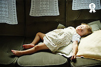Girl (2-4) on sofa, eyes closed (Licence this image exclusively with Getty: http://www.gettyimages.com/detail/200339705-001 )