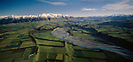 Aerial of patchwork of crops and green fields of the Canterbury Plains. Mount Hutt in background. New Zealand.