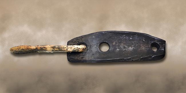 Bone hook & eye fastener thought to be for fastening clothing. Many have been found at Catalhoyuk . Catalhoyuk collection, Konya Archaeological Museum, Turkey
