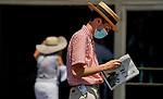 July 18, 2020: A man reads the program on Haskell Invitational Day at Monmouth Park Racecourse in Oceanport, New Jersey. Scott Serio/Eclipse Sportswire/CSM