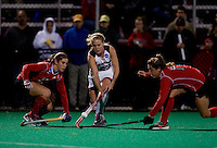 Harriet Tibble (23) of Maryland splits the defense of Berta Queralt (18) and Paula Pastor-Pitarque (17) of Ohio State during the NCAA Field Hockey Championship semfinals in College Park, MD.  Maryland defeated Ohio State, 3-1.