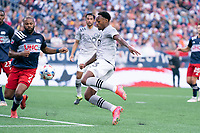 FOXBOROUGH, MA - JULY 25: Mason Toye #13 of CF Montreal takes a shot at goal with Andrew Farrell #2 of New England Revolution coming in to defend during a game between CF Montreal and New England Revolution at Gillette Stadium on July 25, 2021 in Foxborough, Massachusetts.