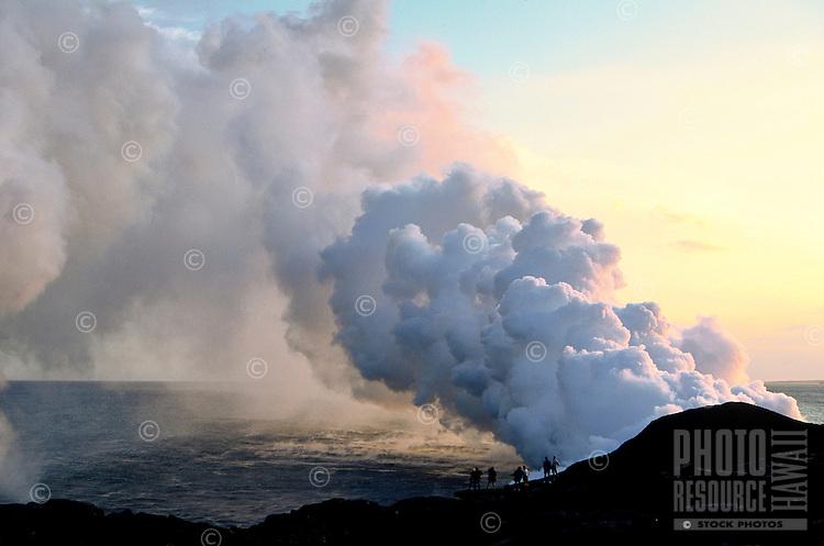 Spectator watches as new lava flows from Kilauea volcano, Hawaii volcanoes national park, Big Island