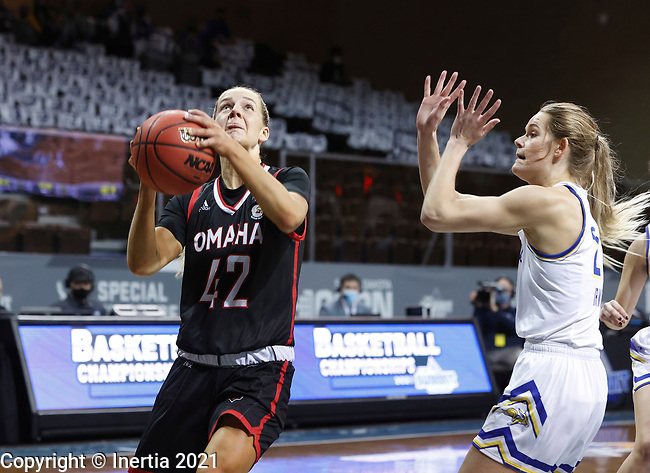 SIOUX FALLS, SD - MARCH 6: Sophie Johnston #42 of the Omaha Mavericks takes the ball tot he basket against the  South Dakota State Jackrabbits during the Summit League Basketball Tournament at the Sanford Pentagon in Sioux Falls, SD. (Photo by Richard Carlson/Inertia)