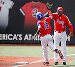 ABERDEEN, MD - AUGUST 02: Peter Vazquez #12 of Puerto Rico after hitting a home run in the 1st inning and is congratulated by Coach Carlos Texidor #21 of Puerto Rico during a game between the Dominican Republic and Puerto Rico during the Cal Ripken World Series at The Ripken Experience Powered by Under Armour on August 2, 2016 in Aberdeen, Maryland. (Photo by Ripken Baseball/Eclipse Sportswire/Getty Images)