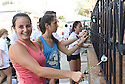 Tulane freshmen Melanie Simon, Leia Kessler, Chaire Demorest and Sarah Ong paint a porch while volunteering with South Seventh Ward Neighbors, 2016.