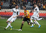 Partick Thistle's Kris Doolan scores against Hearts as Kevin McHattie and Brad McKay are dejected