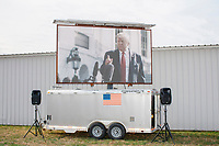 A video screen displays US President Donald Trump before his arrival at a Make America Great Again Victory Rally in the final week before the Nov. 3 election at Pro Star Aviation in Londonderry, New Hampshire, on Sun., Oct. 25, 2020.