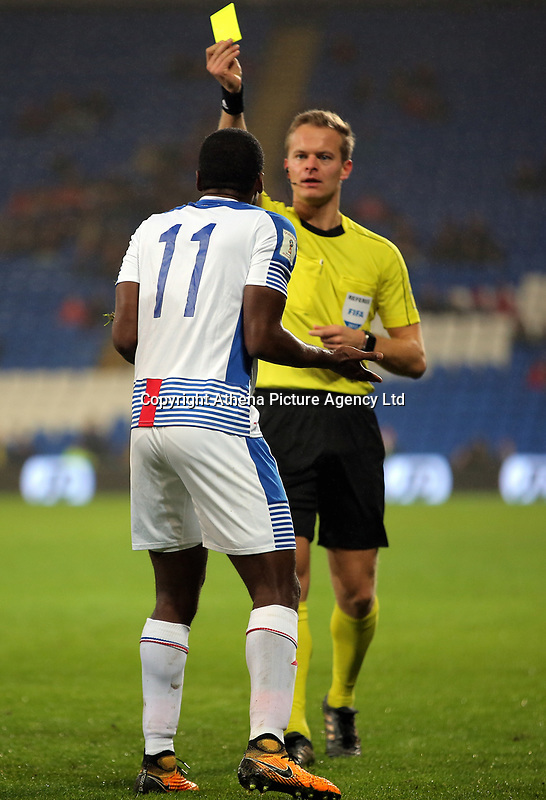 Referee Bart Vertenten (R) shows a yellow card to Armando Cooper of Panama for his foul against Ben Woodburn of Wales during the international friendly soccer match between Wales and Panama at Cardiff City Stadium, Cardiff, Wales, UK. Tuesday 14 November 2017.