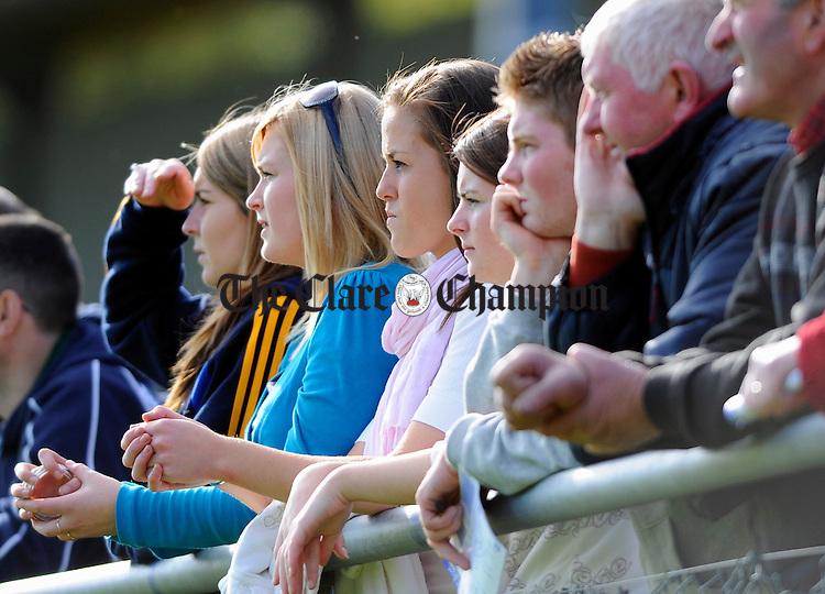 The party faithfull enjoy thye intermediate game between Killanena and Broadford at Scariff. Photograph by John Kelly.