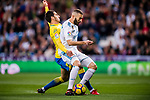 Karim Benzema of Real Madrid (R) fights for the ball with Pedro Bigas Rigo of UD Las Palmas (L) during the La Liga 2017-18 match between Real Madrid and UD Las Palmas at Estadio Santiago Bernabeu on November 05 2017 in Madrid, Spain. Photo by Diego Gonzalez / Power Sport Images