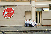 Kitchen staff take a cigarette break outside the Spaghetti House restaurant in central London