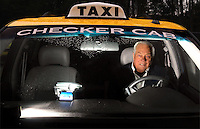 Checker Cab Company of Jacksonville owner Grady Braddock is pictured in one of the company vehicles in Jacksonville, Florida.