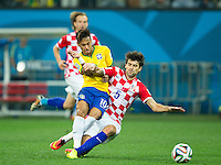 Neymar of Brazil gets taken out by Vedran Corluka of Croatia