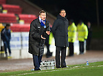 St Johnstone v Ross County...17.11.12      SPL.Steve Lomas encourages his players as Derek Adams looks on.Picture by Graeme Hart..Copyright Perthshire Picture Agency.Tel: 01738 623350  Mobile: 07990 594431