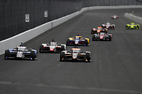 28th May 2021; Indianapolis, Indiana, USA;  NTT Indy Car Series car driver Graham Rahal (15) leads a pack of cars into turn one as he prepares for the 105th running of the Indianapolis 500