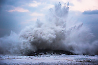 A powerful wave explodes over the reef on its way to shore, Lumahai Beach, Kaua'i.