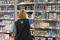 An employee works in the new store