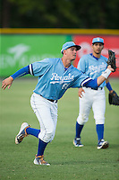 Burlington Royals left fielder Brandon Thomasson (66) catches a fly ball during the game against the Danville Braves at Burlington Athletic Park on August 13, 2015 in Burlington, North Carolina.  The Braves defeated the Royals 6-3. (Brian Westerholt/Four Seam Images)