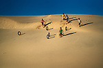 Kids play on the sand dunes by Trung Anh