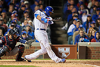 Chicago Cubs Jason Heyward (22) hits a single in the eighth inning during Game 5 of the Major League Baseball World Series against the Cleveland Indians on October 30, 2016 at Wrigley Field in Chicago, Illinois.  (Mike Janes/Four Seam Images)
