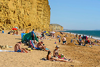 BNPS.co.uk (01202 558833)<br /> Pic: Graham Hunt/BNPS<br /> Date: 7th September 2021.<br /> <br /> Sunbathers on the busy beach enjoying the scorching hot sunshine at the seaside resort of West Bay in Dorset during a mini heatwave.