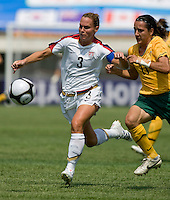 USWNT defender (3) Christie Rampone holds off Australian forward (11) Lisa DeVanna during the Peace Queen Cup  in Suwon, South Korea.  The U.S. defeated Australia, 2-1, at the Suwon Sports Complex.