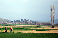 Pictured: Migrants walk in the fields to reach Idomeni Thursday 03 March 2016<br /> Re: Migrants have closed off the railway track at the Greek Fyro Macedonian border in Idomeni, Greece,