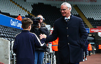 Leicester City manager Claudio Ranieri shakes hands with a mascot as he arrives before the Barclays Premier League match between Swansea City and Leicester City played at The Liberty Stadium on 5th December 2015