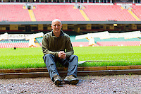 Lee Evans, Head Groundsman at the Millennium Stadium poses for photographs on a bench which now bears the words Millennium Stadium, handwritten by the Desso workers alongside the names of other major sports stadiums that have called in the Desso experts, including Wembley Stadium, Twickenham and the home of Real Madrid. Cardiff, United Kingdom 7th October 2014