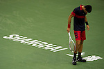 SHANGHAI, CHINA - OCTOBER 13:  Novak Djokovic of Serbia reacts during his match against Ivan Ljubicic of Croatia during day three of the 2010 Shanghai Rolex Masters at the Shanghai Qi Zhong Tennis Center on October 13, 2010 in Shanghai, China.  (Photo by Victor Fraile/The Power of Sport Images) *** Local Caption *** Novak Djokovic