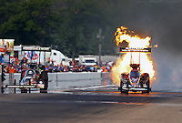Aug. 18, 2013; Brainerd, MN, USA: NHRA top fuel dragster driver Spencer Massey explodes his engine racing alongside Brittany Force during the Lucas Oil Nationals at Brainerd International Raceway. Mandatory Credit: Mark J. Rebilas-