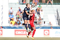 Cary, North Carolina  - Saturday August 19, 2017: Kristen Hamilton out jumps Tori Huster during a regular season National Women's Soccer League (NWSL) match between the North Carolina Courage and the Washington Spirit at Sahlen's Stadium at WakeMed Soccer Park.